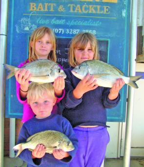A couple very happy young anglers showing off their impressive bream haul.