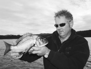 Treyton with a beaut winter black bream from Merimbula Lake, caught on a soft plastic and released after a few photos.