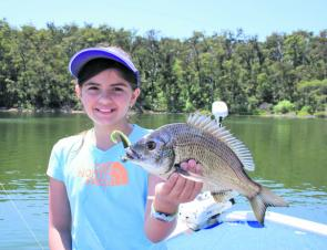 Sophie McKay, 10, with her first ever fish, a 32cm bream caught on a soft plastic. Sophie chose to release it after a few happy snaps.