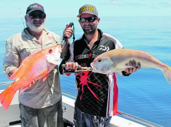 Ross and Mick with a delicious duo for dinner – nannygai and goldband snapper caught wide of the reef.