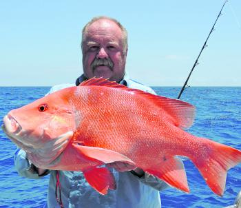 Scott Lynch with a beautiful red emperor off the reefs.