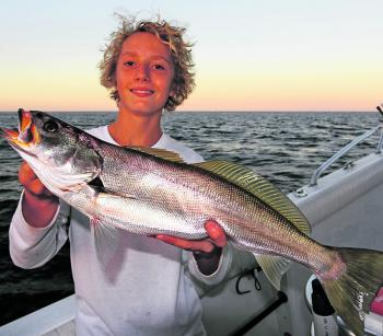 Zane Levett with a reef teraglin.