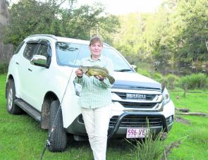 The cod's a little bloke, destined to be returned, but the Isuzu MU-X made river access through rough going easy work.