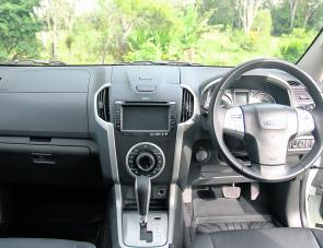 The Isuzu's eye- pleasing dash layout: dark charcoal interspersed with brushed metal tonings adds a subdued touch of class.