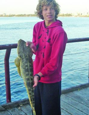 'The Boy' with a 62cm flathead taken from the boardwalk in Caloundra.