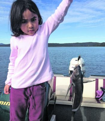 Crystal enjoyed catching a fish but wasn't as keen on picking it up!