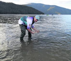 Releasing Dean O'Keefe's 1.19kg brown trout on Sunday afternoon.
