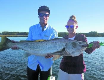 Shelly and Johns hold this cracking 110cm mulloway that Shelly caught on a plastic in the Hastings.