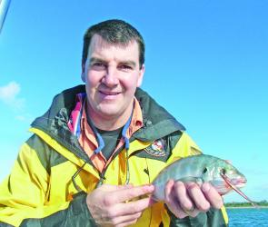 "John Ansell with a nice trevally caught on a Berkley 3"" Minnow inside the entrance."
