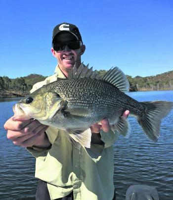 Andrew Shultz with a 49cm fork length bass caught hopping a blade through bait schools in Cania Dam.