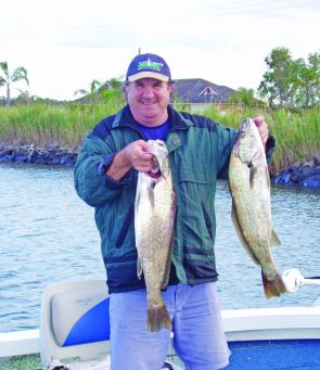 "Wayne Lyons of Brisbane with a brace of Ballina school jew caught on Atomic 4"" Shads in Carolina pumpkin disco flake."