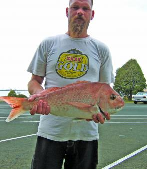 Andrew Caldwell and his snapper caught off the Lee Breakwater.