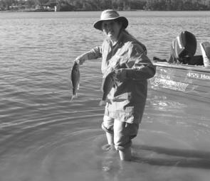 Sue Fleming releasing a pair of Australian bass after the Noosa Water Festival.