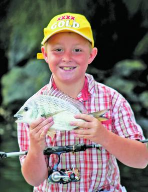Blair Forsythe with a bream caught with his Dad, Brett, on a soft plastic deep along the Coal Wall.