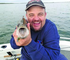 Mouth almighty! Robert Braz releases yet another estuary perch caught out in open lake water.