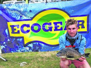 Lewis Holland from Team Rod Battlers displays the 1.36kg Ecogear Big Bream.
