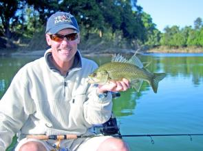 Mike Colless looks pleased with this early season bass. There have been plenty more available on most trips.