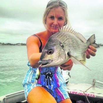 Tayla Egan with a solid bream caught on an Atomic Metalz Blade.