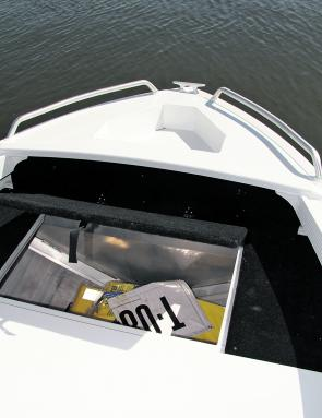 There is ample space for life jackets and other safety equipment up the bow end of the 420.
