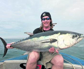 Longtail tuna to 20kg and bigger will be zooming around the shallows this month.