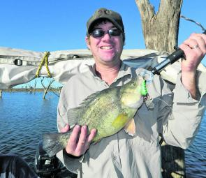 John Feebrey is all smiles as he lands another Lake Keepit yellowbelly.