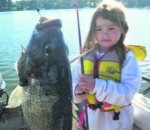 Seana Hedley with a Lakes Entrance 44cm bream caught on a spider crab.