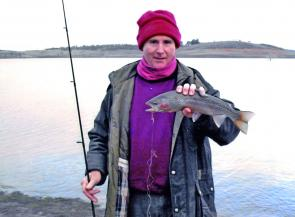David Knight, still rugged up for cold weather, with a typical fat Spring rainbow taken on PowerBait in Lake Eucumbene.