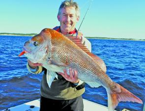 Paul Burke landed this lovely 8.37kg snapper off the Golf Course on a red and green Slam plastic.