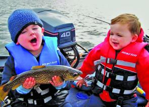 Jag Stevens holding a nice brown trout and Chase Stevens is also very excited. Photo courtesy Malcolm Stevens