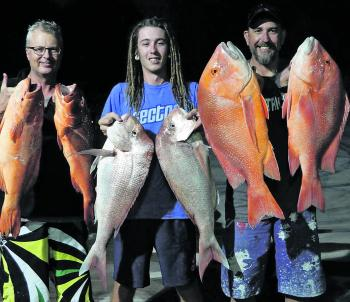 Shaun and the crew with handfuls of reds, snapper and trout caught offshore of 1770.