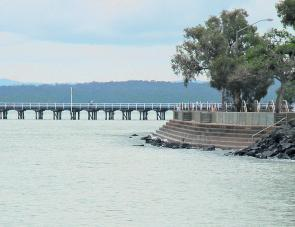 The steps of the sea wall at Urangan is particularly popular over the high tide.