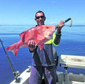 Graham Edmunds with a shallow water red emperor.
