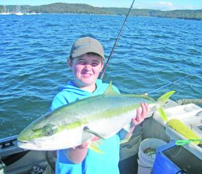Wilson Evans, 11, struggles to hold up his 84cm kingfish.