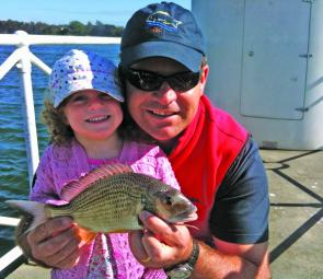 Madeline Poulton with her first solo capture, a bream caught on fresh prawns.