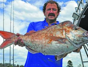 Tony Evans with a thumping 9kg snapper taken on a soft plastic.