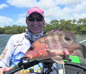A decent golden snapper taken while fishing plastics in a deep hole.