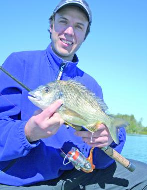 Craig Everitt with a nice bream caught fishing the flats for flathead.