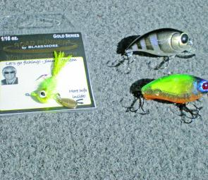 At left is the new lure Blakemore combination of a fly and spinner. At right are two wakebaits, the top one the Smith Pebble SR and below is the Jackall 0 Footer Cherry.