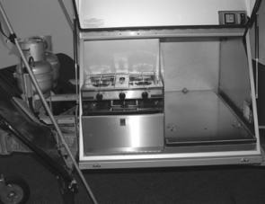 An easily accessed stove is one feature that's important in a modern offroad camper unit.