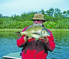 Greg Jerkins with a 50cm bream taken on a Strike Pro Bass X lure. The fish was released to fight another day.