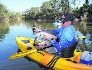 Local kayakers are cashing in on a barra bonanza since the floods.