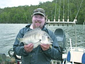 The author with a thumping yellowfin bream well over a kilo, taken on a surface walker.