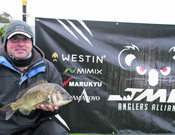 Michael Pelle from Team The Old Boys displays the 1.56kg JML Anglers Alliance Big Bream
