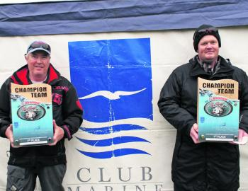Club Marine East Gippsland Bream Classic champions Team Pro-strikes Peter Stephens and Bradley Baade display their trophies to the crowd