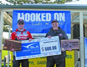 Brad Hodges and Mike Hodges from Team Berkley display the Hooked On Rods 'N' Reels Champions Trophies to the crowd after their victory.