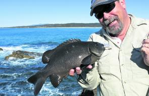 The author with a black drummer taken from the ocean rocks on a heavy gauge No. 1 hook.