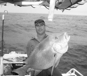 Craig Abblit from Brisbane with a 14kg Rainbow Beach red, worth the effort on any day.