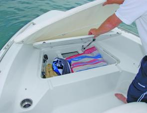 An insulated storage area is mounted right up front; the bow cushion lifts to access it.