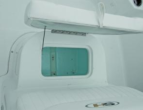 A 40L insulated and drained locker is mounted under the seat in front of the Triton's console.
