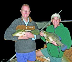 Greg Mitchell and Les Kowitz, BP Dam members, with a sample catch of golden perch and Australian bass.